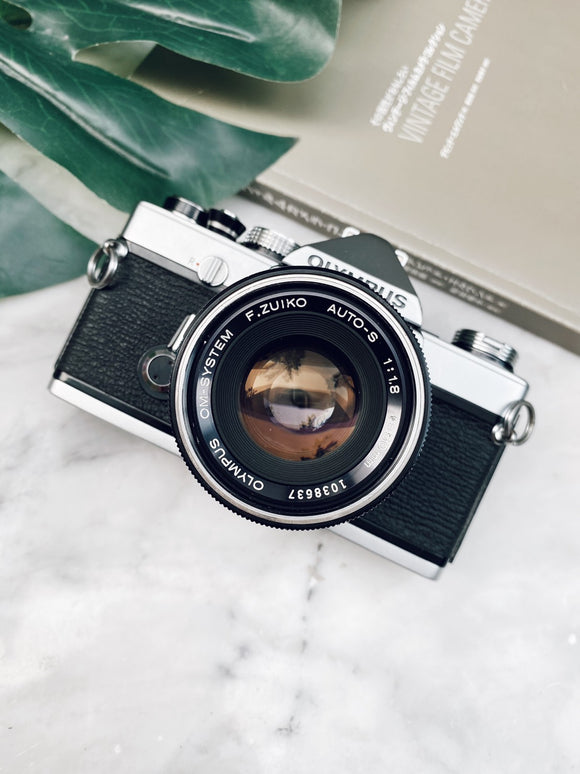 Olympus OM-1 Silver with Lens