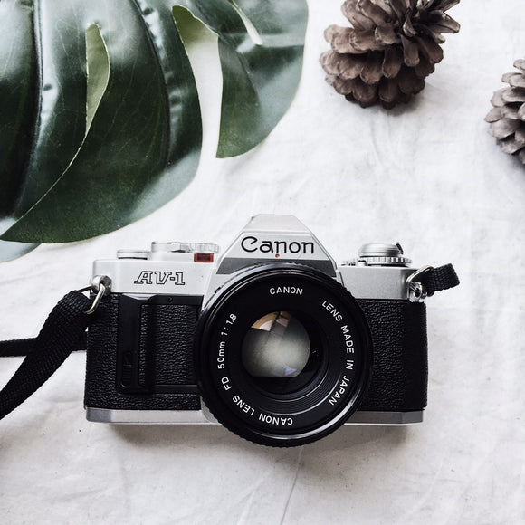 Canon AV-1 silver with Lens