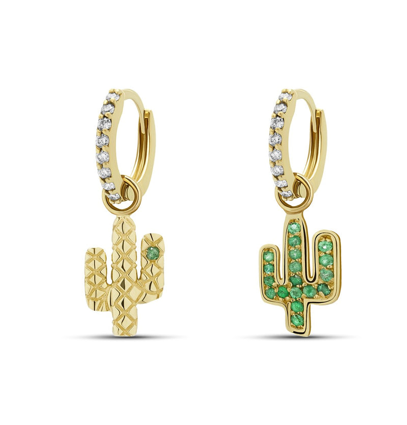 Our 14 karat gold huggie earrings are striking, elegant and have a unique glow! The charm features handset emerald stones whereas the huggies are handset with diamond pave stones.