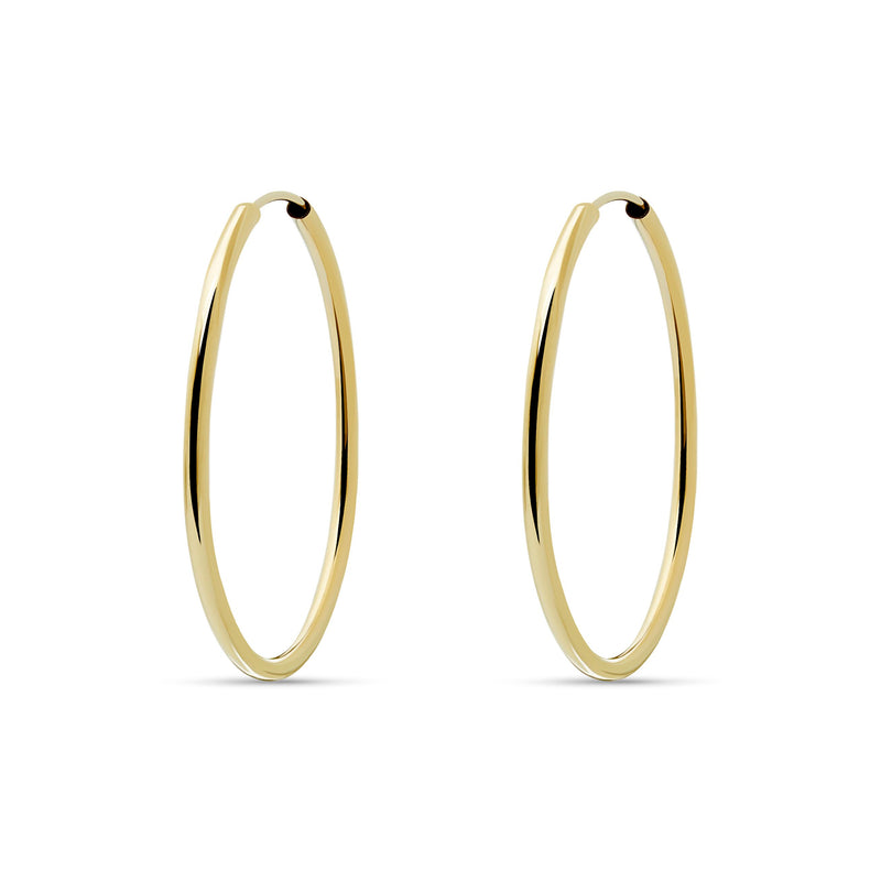 This 14 karat gold hoop earring measures 38mm and is one of our favorite essentials. Despite their size, these earrings are very comfortable and light.