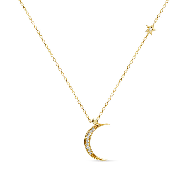 A magical 14 karat gold diamond necklace that will become your day to night companion. Moon magic diamond gold necklace.