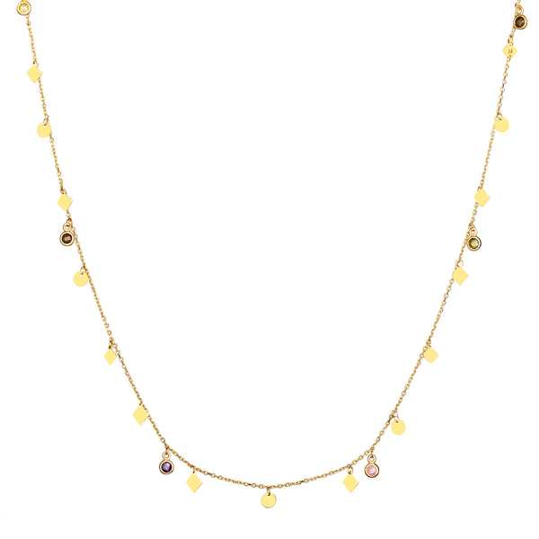 The Nomad Necklace in 14 karat gold is our longest handmade necklace (100cm) and can be worn in many ways. This gold chain with its dazzling charms and stones is the ultimate piece for a layering look.