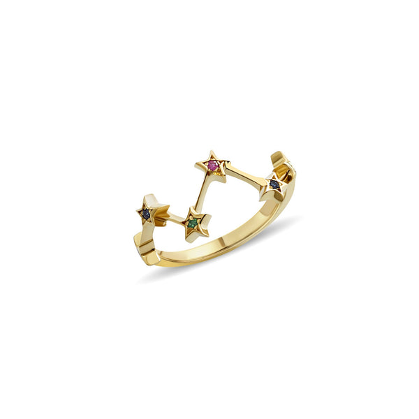 A 14 karat gold ring with handset gemstones. Our Multiple Star Ring is inspired by warm nights of star gazing. The emerald, sapphire and ruby stones add a playful glow to your hand.