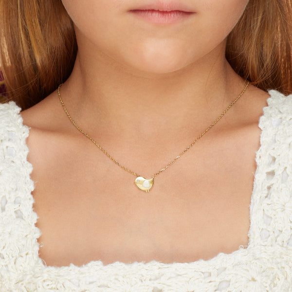 Our 14 karat gold necklace for girls. This adorable bird necklace features pearl enamel hand-painting and a diamond eye that will make her sparkle. Kids jewelry