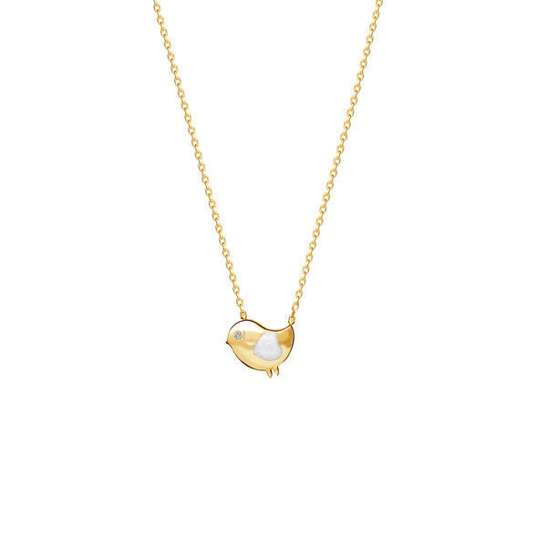 Our 14 karat gold necklace for girls. This adorable bird necklace features pearl enamel hand-painting and a diamond eye that will make her sparkle.