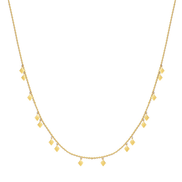This delicate and playful 14 karat gold necklace features dangling tribal gold charms. Its simple style mixes and matches easily with other jewels and is the perfect accessory for a layering look.
