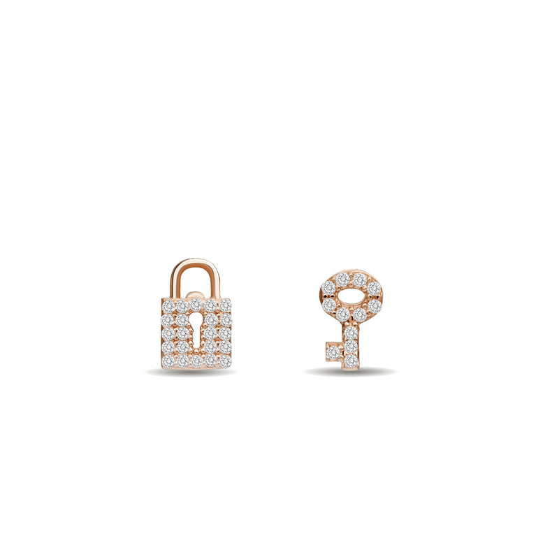 Our 14K gold diamond earring studs with a handset diamond pave are the ultimate love symbol. Lock and key diamond earrings rosegold.