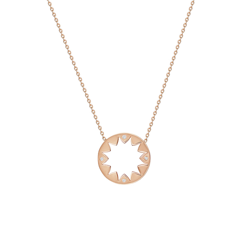 This 14 karat gold diamond pendant is inspired by mediterranean summer days and is the ultimate piece for sun-worshippers. The pendant features 4 handset sparkling diamonds pointing out the cardinal points.