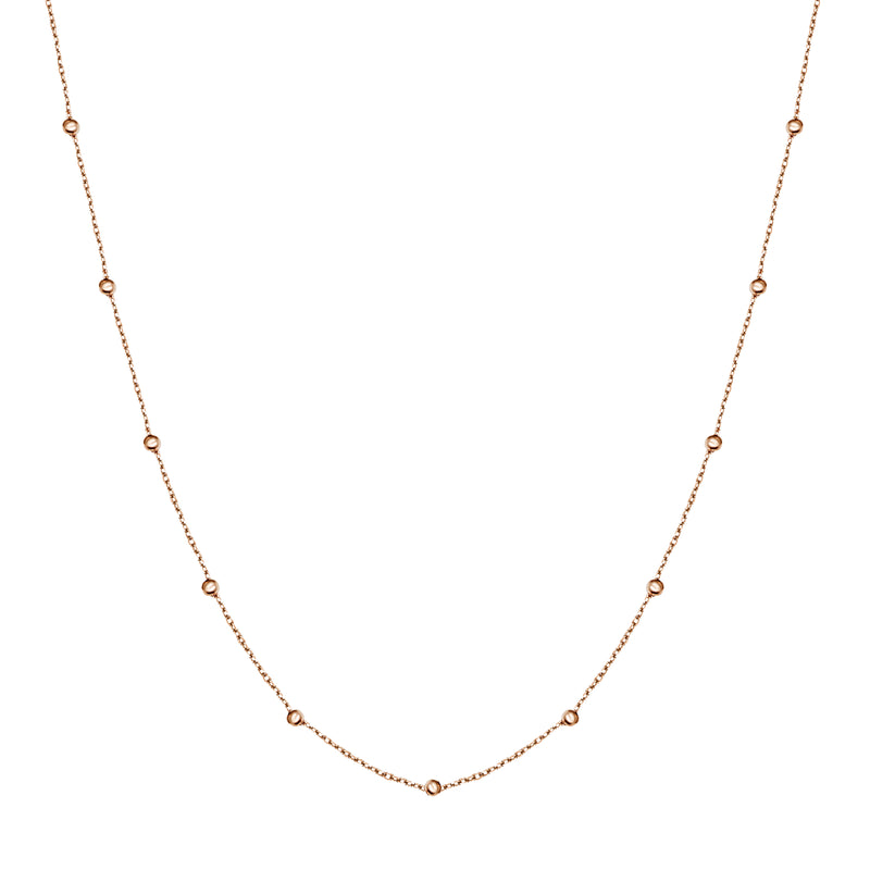 This ball chain necklace in 14 karat gold features petit balls aligned along the gold chain. Wear it by itself or combine with other gold necklaces for the ultimate layering look.