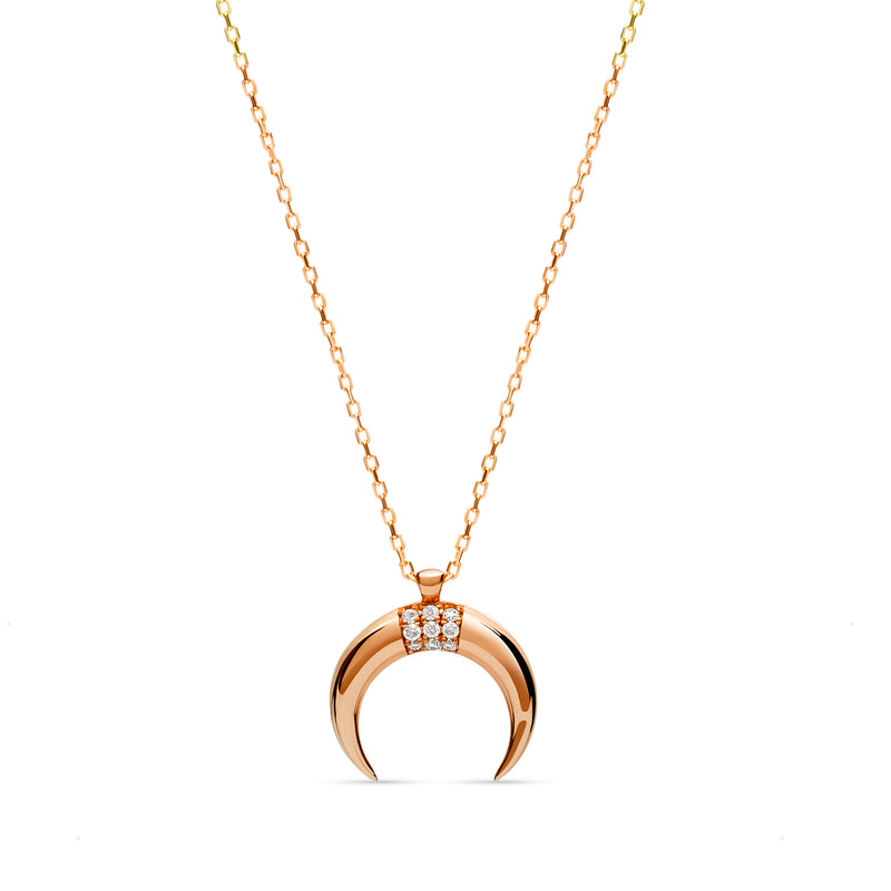 Feel like the queen of the universe with our our 14 karat gold Diamond Luna Pendant.  This gold pendant in shape of a moon features handset brilliant cut diamonds.