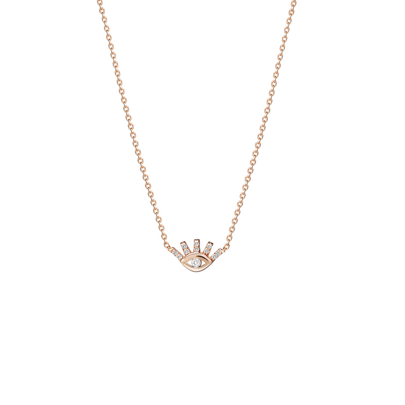 This 14 karat gold eye diamond necklace is our dream jewelry piece. The gold pendant necklace features pave set diamonds on the lashes and a bigger diamond stone in the center of the eye.