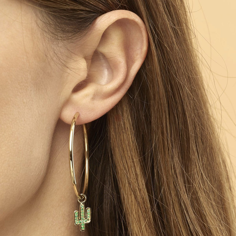 Our two piece 14 karat gold hoop earrings are striking, elegant and make a statement! The hoop earrings feature the Cactus Charms with handset emerald gemstones. Also available in rose gold.