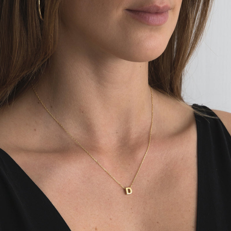 "A 18 karat gold vermeil necklace with your initial letter ""D"". This diamond letter necklace is a special jewelry necklace that can be worn day and night. A genuine diamond stone in the corner of the letter makes this gold diamond necklace a luxury and ideal gift for yourself, your best friend or loved one."
