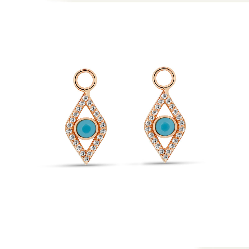 Our dazzling 14 karat gold charms for hoops feature the turquoise evil eye embodied in diamonds. Wear these charms on our Diamond Huggies or Essential Hoops for an extra dose of sparkle. Also available in  rose gold.