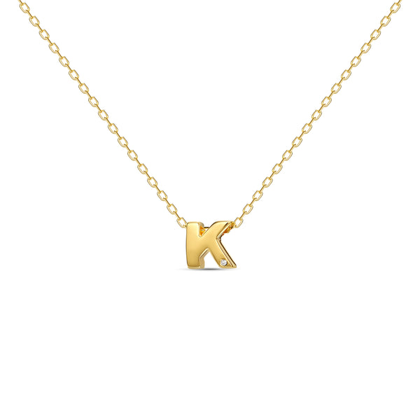 "A 18 karat gold vermeil necklace with your initial letter ""K"". This diamond letter necklace is a special jewelry necklace that can be worn day and night. A genuine diamond stone in the corner of the letter makes this gold diamond necklace a luxury and ideal gift for yourself, your best friend or loved one."