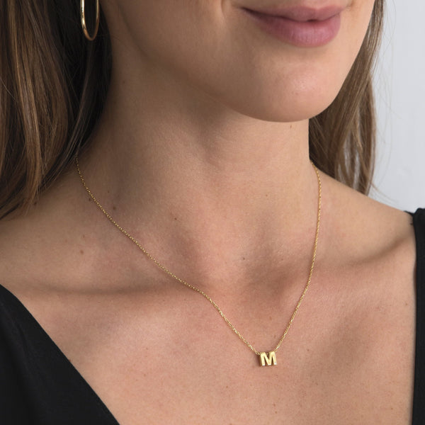 "A 18 karat gold vermeil necklace with your initial letter ""M"". This diamond letter necklace is a special jewelry necklace that can be worn day and night. A genuine diamond stone in the corner of the letter makes this gold diamond necklace a luxury and ideal gift for yourself, your best friend or loved one."