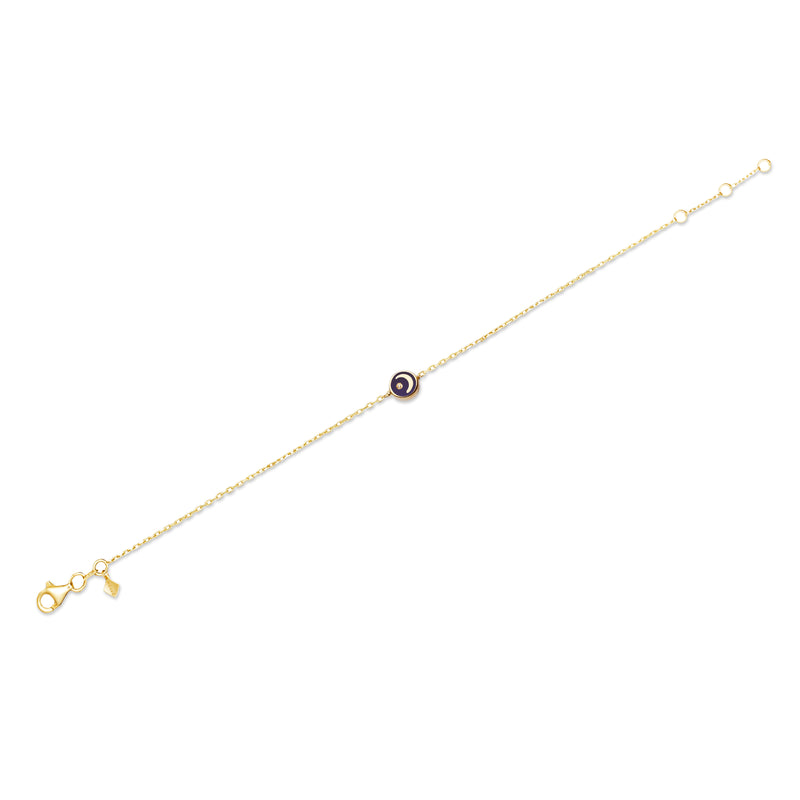 This handmade 14 karat gold diamond bracelet is the perfect every day gold accessory. Its pendant features a hand-painted and two-sided enamel moon with a shining diamond star.