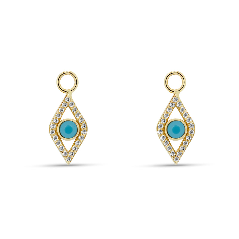 Our dazzling 14 karat gold charms for hoops feature the turquoise evil eye embodied in diamonds. Wear these charms on our Diamond Huggies or Essential Hoops for an extra dose of sparkle.