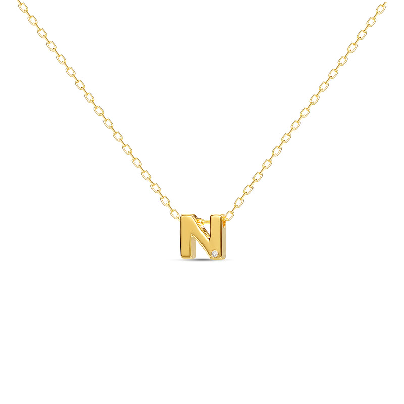 "A 18 karat gold vermeil necklace with your initial letter ""N"". This diamond letter necklace is a special jewelry necklace that can be worn day and night. A genuine diamond stone in the corner of the letter makes this gold diamond necklace a luxury and ideal gift for yourself, your best friend or loved one."