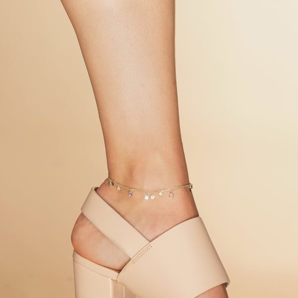This double chain 14 karat gold ankle bracelet is one of our bestsellers!  The double chain anklet with all its shimmer, colours and little charms will accompany you with every step you take.