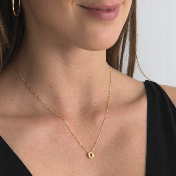 "A 18 karat gold vermeil necklace with your initial letter ""O"". This diamond letter necklace is a special jewelry necklace that can be worn day and night. A genuine diamond stone in the corner of the letter makes this gold diamond necklace a luxury and ideal gift for yourself, your best friend or loved one."