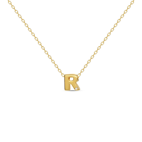 "A 18 karat gold vermeil necklace with your initial letter ""R"". This diamond letter necklace is a special jewelry necklace that can be worn day and night. A genuine diamond stone in the corner of the letter makes this gold diamond necklace a luxury and ideal gift for yourself, your best friend or loved one."