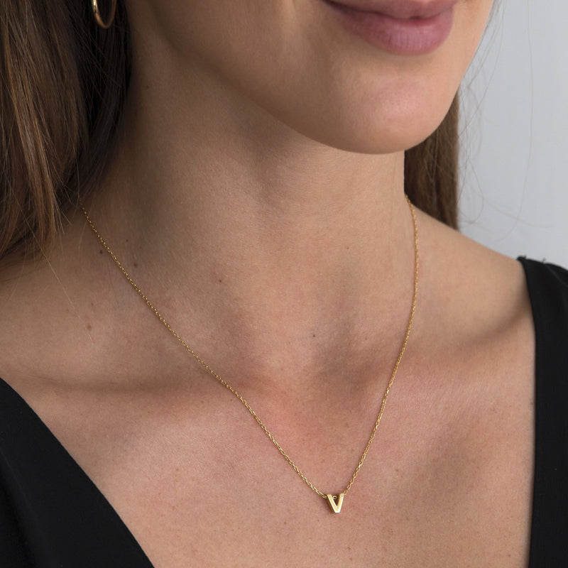 "A 18 karat gold vermeil necklace with your initial letter ""V"". This diamond letter necklace is a special gold necklace that can be worn day and night. A genuine diamond stone in the corner of the letter makes this gold diamond necklace a luxury and ideal gift for yourself, your best friend or loved one."
