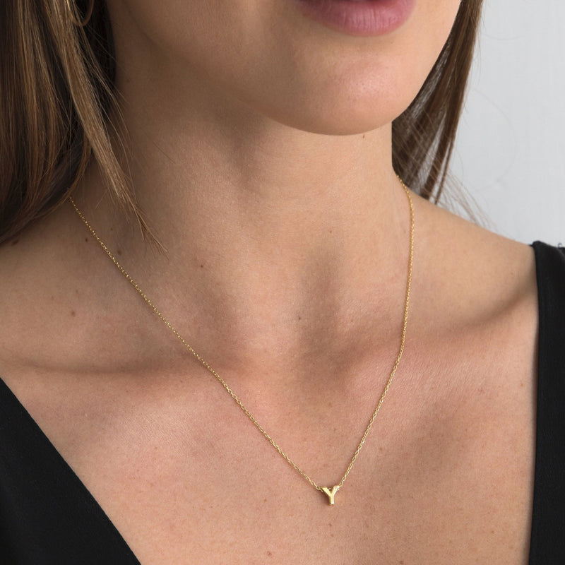 "A 18 karat gold vermeil necklace with your initial letter ""Y. This diamond letter necklace is a special gold necklace that can be worn day and night. A genuine diamond stone in the corner of the letter makes this gold diamond necklace a luxury and ideal gift for yourself, your best friend or loved one."