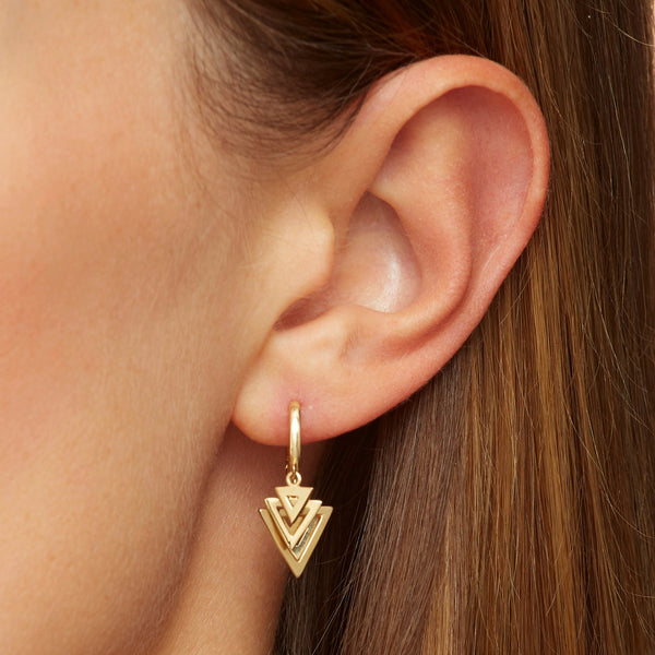 Our 14 karat gold bestseller earrings featuring triangle charms.