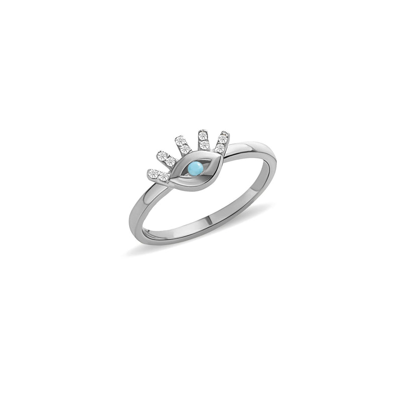 This 14 karat gold diamond ring is our dream jewelry piece. The turquoise stone in the center of the eye is encased with pave set diamond lashes. A magical gold ring that lasts a lifetime.