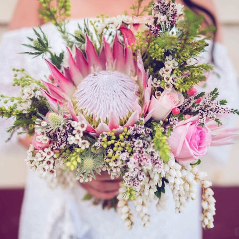 Incredibly Pink Bridal Bouquet featuring a Pink King Protea, Pink Roses, Andromeda and an array of Foliages and Native and Seasonal Flowers. Wedding Geelong Melbourne Lustre Blooms