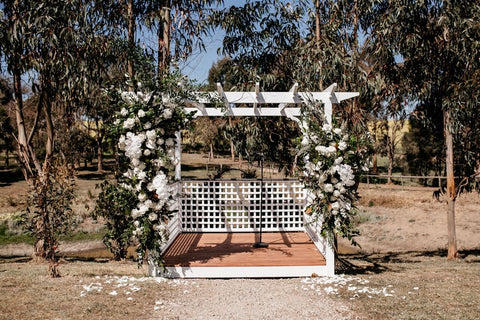Hamptons styles Wedding ceremony Arbour featuring incredible white roses in Geelong and Melbourne