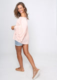 Blush off the shoulder top with pretty flared arm design.
