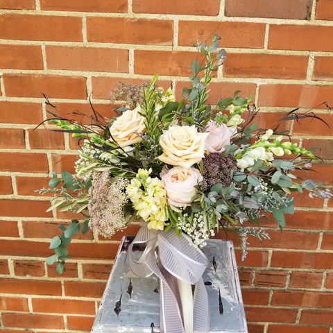 full bouquet of neutral flowers with greenery