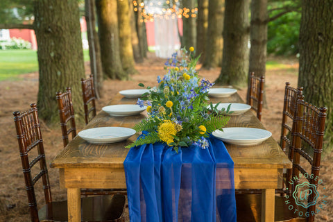 woodland and vibrant greenery on table centerpieces at wedding