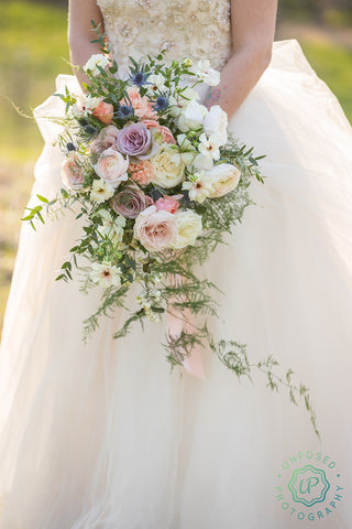 bride's cascading bouquet of flowers