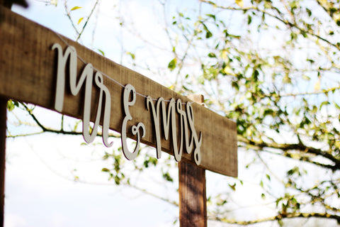 wooden post with mr and mrs sign