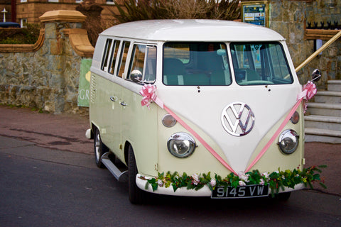 volkswagon van decorated for bride and groom