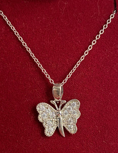 Silver butterfly pendant and earrings