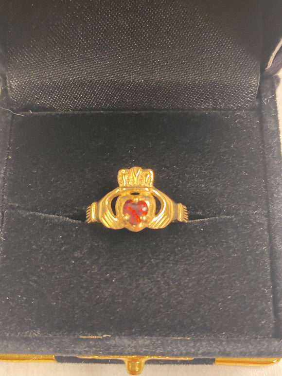 Gold Claddagh Ring with Garnet Stone