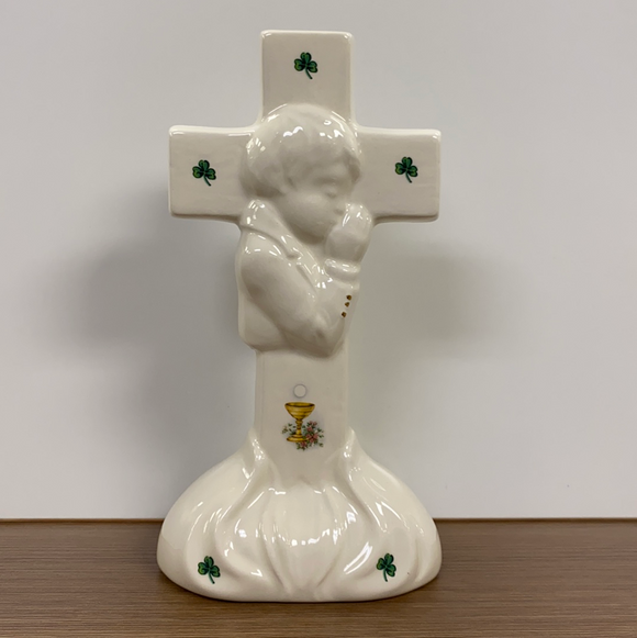 Boy standing first communion cross