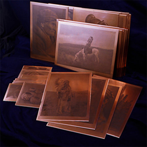 a display of the curtis photogravure plates on a black background