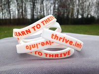 Glow-in-the-dark THRIVE wristbands