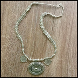 Silver medallion and beaded necklace