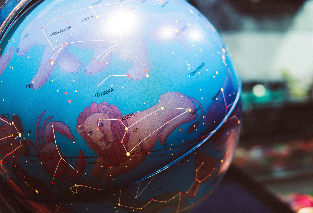 World globe of constellations with illustrations of their mythology