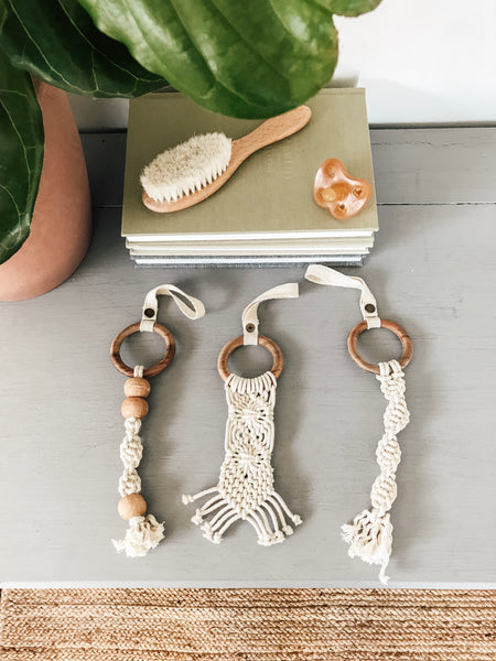 These Finn + Emma organic beaded macrame toys are a 100% zero waste baby toy! Easily clip them to carseats, strollers, high chairs or the wooden play gyms.