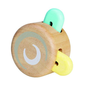 This Peek-A-Boo Wooden Roller Toy has colored pieces that peek in and out when rolled. Made with sustainable and environmentally-safe materials.