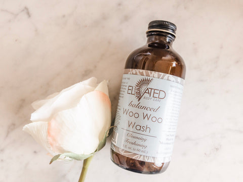 Organic gentle feminine wash from Elevate called Woo Woo Wash. Packaged in glass bottle.