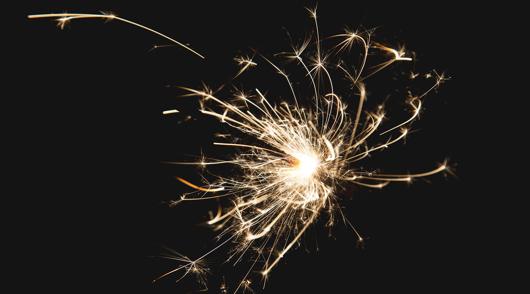 Lit sparkler on black background | Nikki Darling Australia