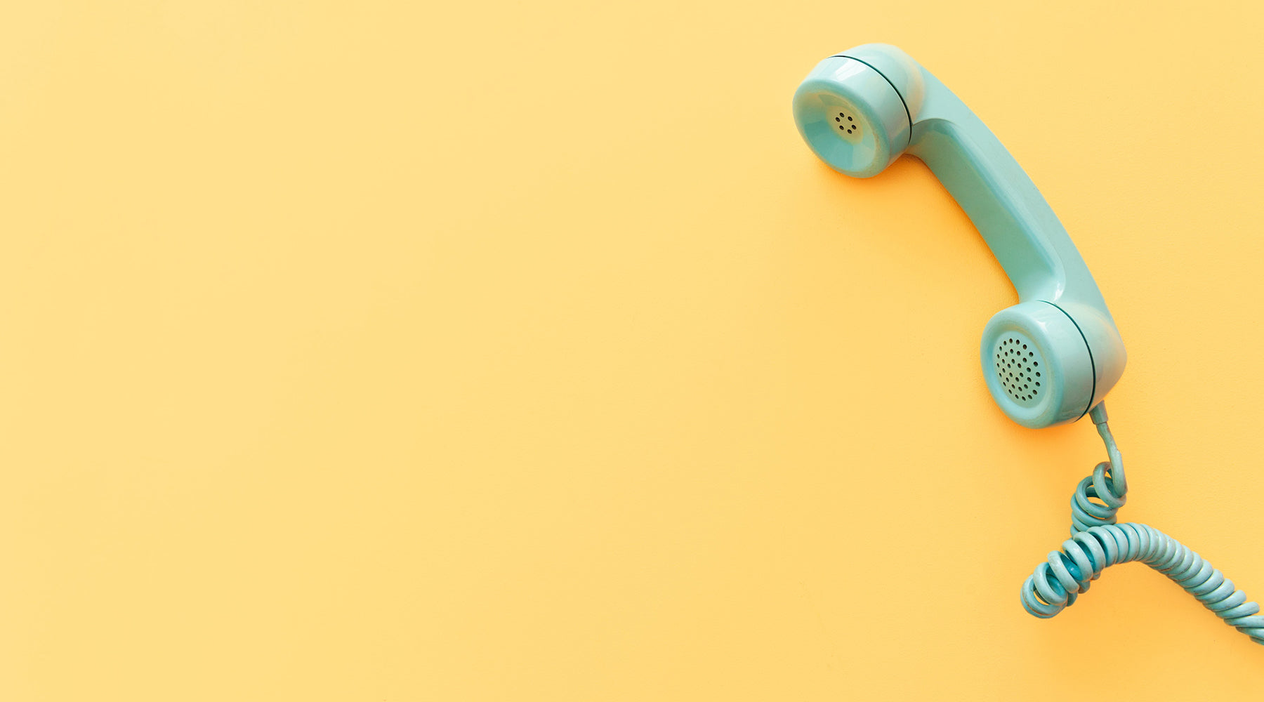 Teal telephone on mustard yellow background |  Nikki Darling Australia